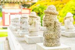 Dol Harubang at Yakcheonsa Temple in Jeju Island. South Korea Royalty Free Stock Image