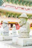 Dol Harubang at Yakcheonsa Temple in Jeju Island. South Korea Stock Images
