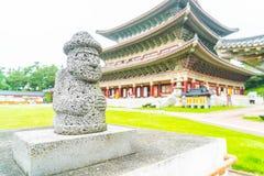 Dol Harubang at Yakcheonsa Temple in Jeju Island. South Korea Stock Photo
