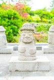 Dol Harubang at Yakcheonsa Temple in Jeju Island. South Korea Royalty Free Stock Photography