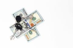 Dolarów rachunki pod kluczami Zdjęcia Royalty Free