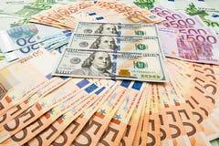 dolar的纸币欧洲和 钞票背景 免版税库存照片