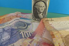 dolar amerykański i południe - afrykańscy skrajów banknoty Obrazy Stock