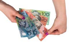 Dolar australijski w kobiety ręce odizolowywającej Obrazy Royalty Free