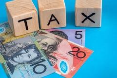 Dolar australijski z drewnianymi sześcianami Zdjęcia Royalty Free