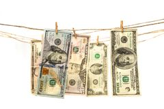 Dolar banknotes hanging on a rope with clothespin. stock photography