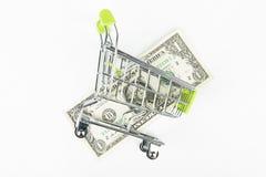 Dolar w wózek na zakupy obrazy royalty free