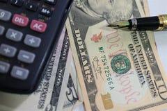 Dolar, waluta, waluta, wymiana, kalkulator, finanse deponuje pieniądze, pieniężny, gospodarka, Obraz Royalty Free