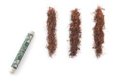 Dolar z tabacznymi kokaina lampasami odizolowywającymi Obrazy Stock