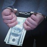 Dolarowi banknoty i kajdanki jako symbol korupcja w j fotografia royalty free