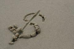 Dolarowy znak na piasku Obrazy Royalty Free