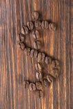 Dolarowy znak od kaw ziaren na drewnianym tle Zdjęcia Stock