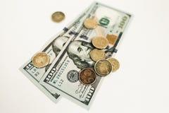 Dolary i centy odizolowywaj?cy na bia?ym tle zdjęcie royalty free