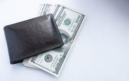 Dolary są na stole w brown kiesie obraz royalty free