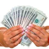 Dolary w żeńskich rękach odizolowywać obrazy stock