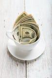 Dolary w filiżance obrazy stock