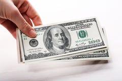 Dolary w ręce, zamykają up Zdjęcia Royalty Free