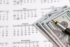 Dolary z kalkulatorem na kalendarzu Fotografia Stock