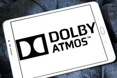 Dolby atmos sound technology logo. Logo of dolby atmos sound technology on samsung tablet. Dolby Atmos is the name of a surround sound technology announced by royalty free stock image