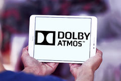 Dolby atmos sound technology logo. Logo of dolby atmos sound technology on samsung tablet . Dolby Atmos is the name of a surround sound technology announced by royalty free stock image