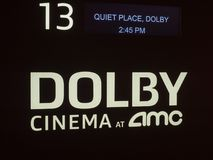 Dolby Cinema at AMC certification logo outside of a movie theater entrance. SAN FRANCISCO, CA – APRIL 21, 2018: Dolby Cinema at AMC certification logo royalty free stock photos