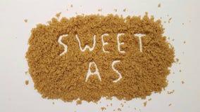 Dolce così ha spiegato in zucchero bruno Dolce come zucchero fotografia stock