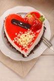Dolce crema delizioso nella forma di cuore Immagini Stock