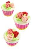 Dolce della tazza con il fiore rosa della crema Fotografia Stock