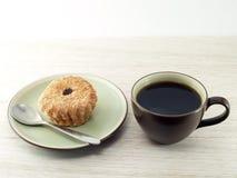 Dolce della tazza e del caffè nero Fotografia Stock