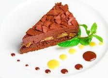 Dolce di cioccolato con il creame del cioccolato sopra Fotografie Stock