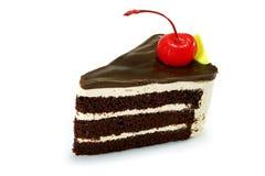 Dolce di cioccolato con la ciliegia rossa Fotografie Stock Libere da Diritti