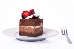 Dolce di cioccolato con la fragola e la forcella Fotografie Stock Libere da Diritti