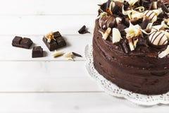 Dolce di cioccolato triplo delizioso Fotografia Stock