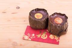 Dolce di riso glutinoso con buona fortuna nelle parole cinesi Immagini Stock