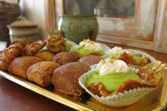 Dolce Italian pastries in rustic country kitchen. Dolce Italian pastries on a tray in rustic country kitchen Stock Photos