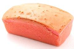 Dolce rosa del burro su fondo bianco Fotografia Stock