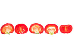 Dolce rosso tagliato intorno a pepe, isolato su fondo bianco Fotografia Stock