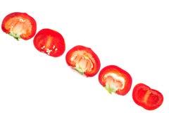 Dolce rosso tagliato intorno a pepe, isolato su fondo bianco Fotografie Stock
