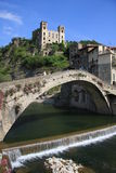 Dolceacqua Ancient Bridge and Doria Castle. Dolceacqua is dominated by the famous bridge that spans the river from the old town to the more modern part. In the royalty free stock images