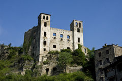 Dolceacqua Doria Castle. Dolceacqua is dominated by the famous bridge that spans the river from the old town to the more modern part. In the photo ancient ruins royalty free stock image
