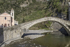 Dolceacqua. The perfectly curved historic arch bridge is the symbol of the small Ligurian town of Dolceacqua Stock Photography