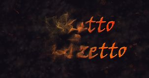 Dolcetto o Schezetto (Trick or Treat) Italian text dissolving into dust from left stock footage