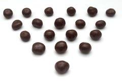 Dolci del cioccolato che formano un triangolo Fotografie Stock Libere da Diritti