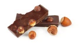 Dolci delle caramelle di cioccolato con la nocciola isolata su bianco Immagine Stock Libera da Diritti