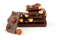 Dolci delle caramelle di cioccolato con la nocciola isolata su bianco Fotografie Stock