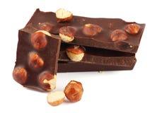 Dolci delle caramelle di cioccolato con la nocciola su bianco Fotografia Stock Libera da Diritti