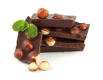 Dolci delle caramelle di cioccolato con la nocciola su bianco Immagine Stock Libera da Diritti