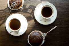 Dolci di cioccolato e della tazza di caffè Immagine Stock