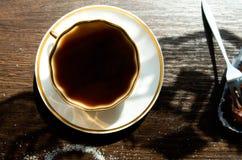 Dolci di cioccolato e della tazza di caffè Fotografia Stock