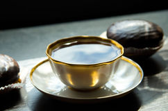 Dolci di cioccolato e della tazza di caffè Fotografie Stock